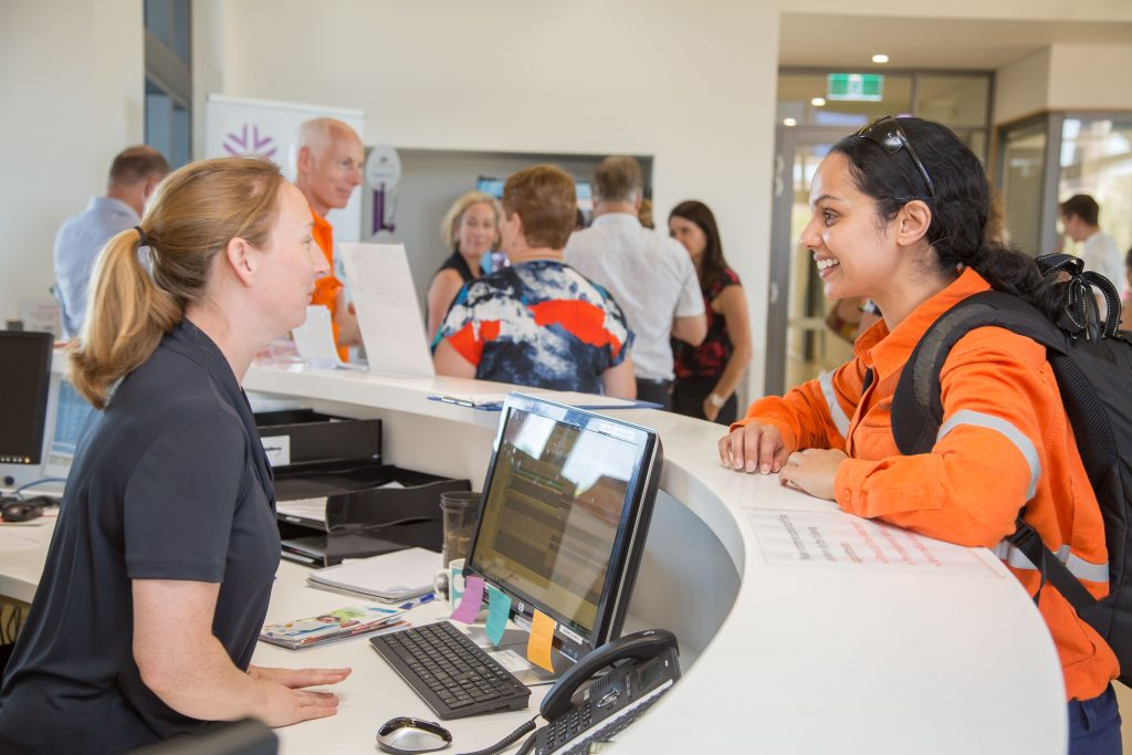 Girl with Receptionist at Karratha Central Healthcare Clinic