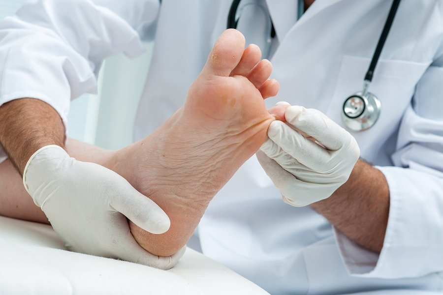 Podiatrist examines the foot on the presence of athlete's foot
